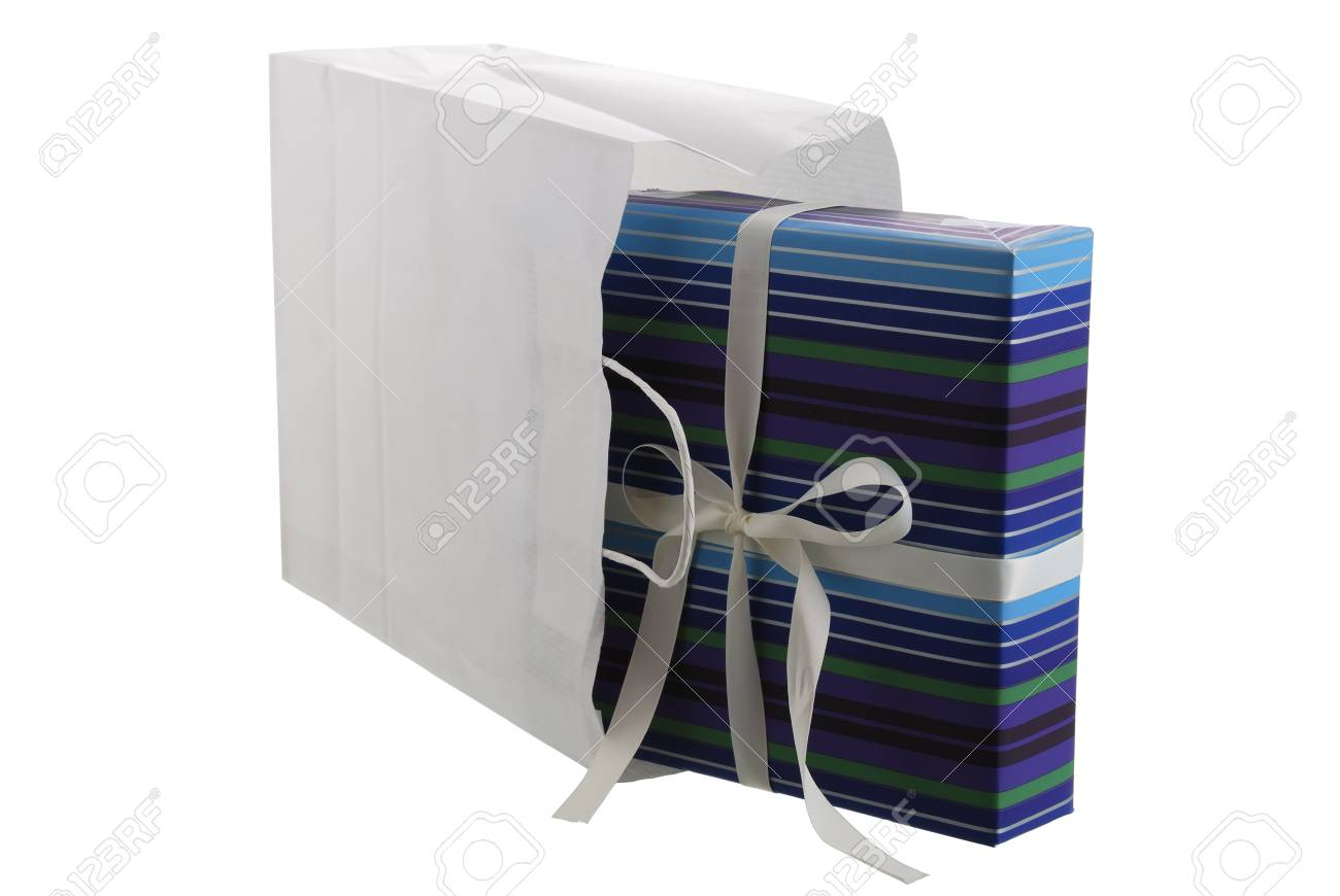 Festive present box wrapped in striped blue paper sticking out from white paper bag isolated on white background Stock Photo - 9238361