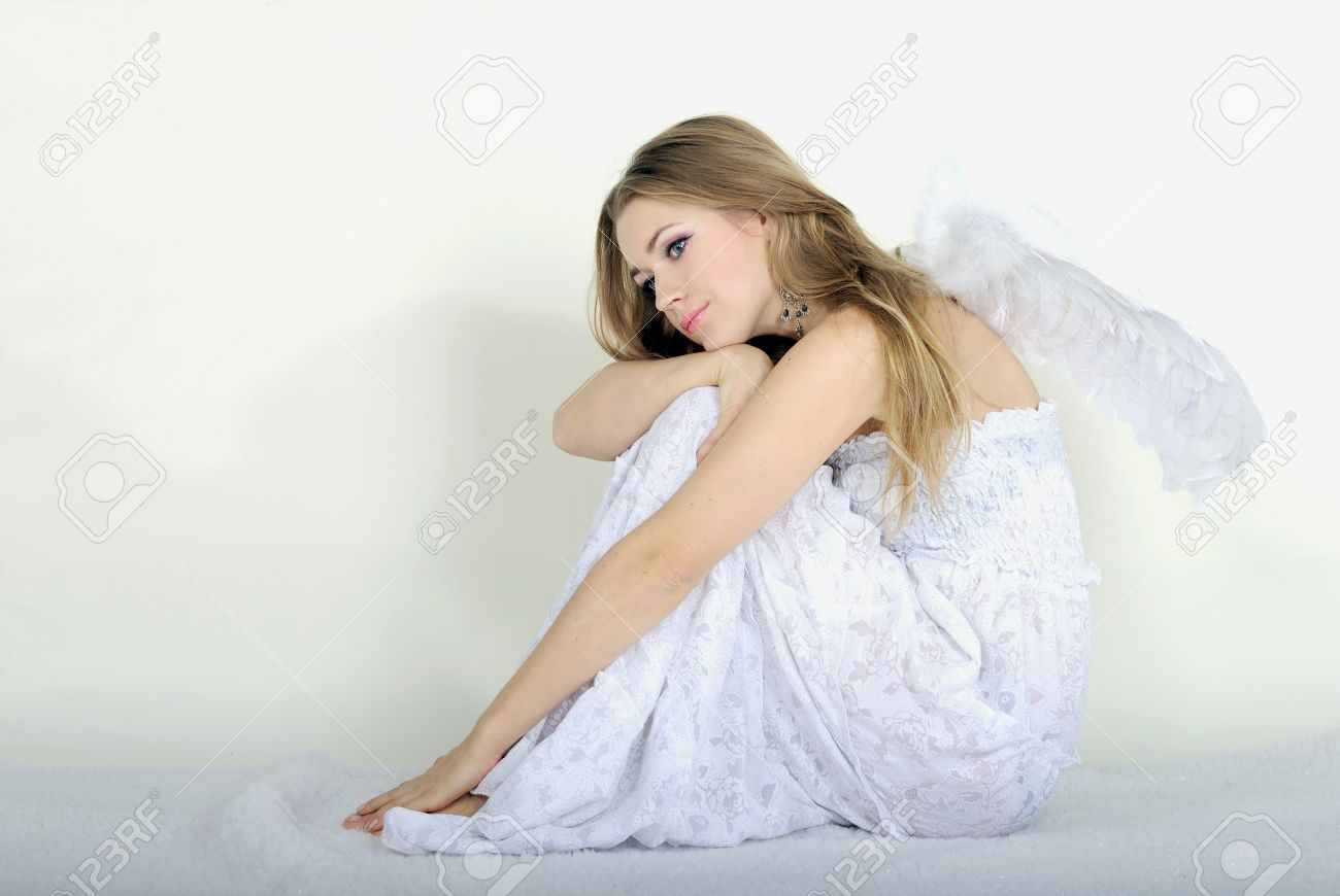 The Young Beautiful Girl An Angel With Wings On A White Background