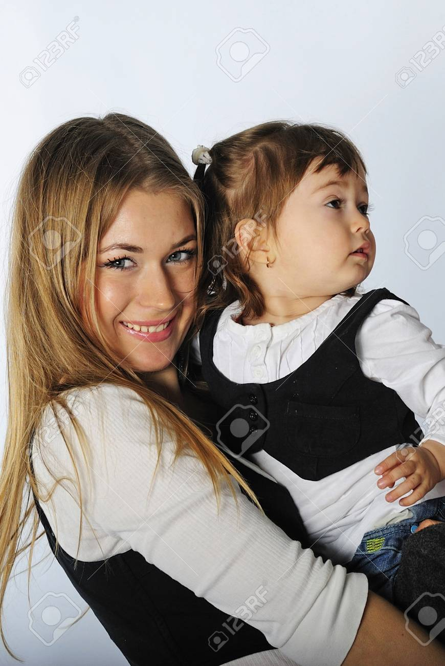 small beautiful girl with ma in in jeans and vest on white background Stock Photo - 13853336