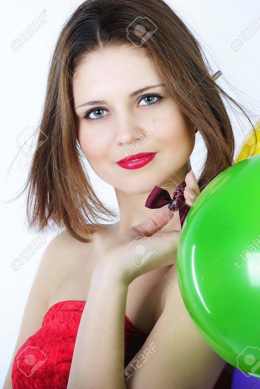 young beautiful girl in red gown with short hair with air ball