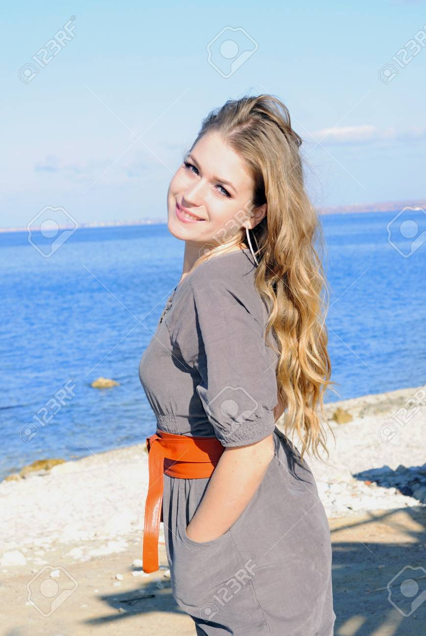 Portrait of the young beautiful girl against the sea Stock Photo - 16788457
