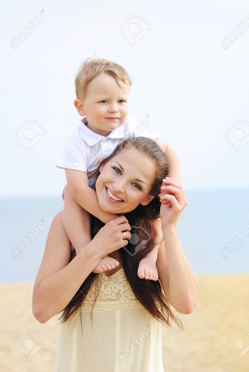 Mother with the child on sandy to seacoast Stock Photo - 18485918