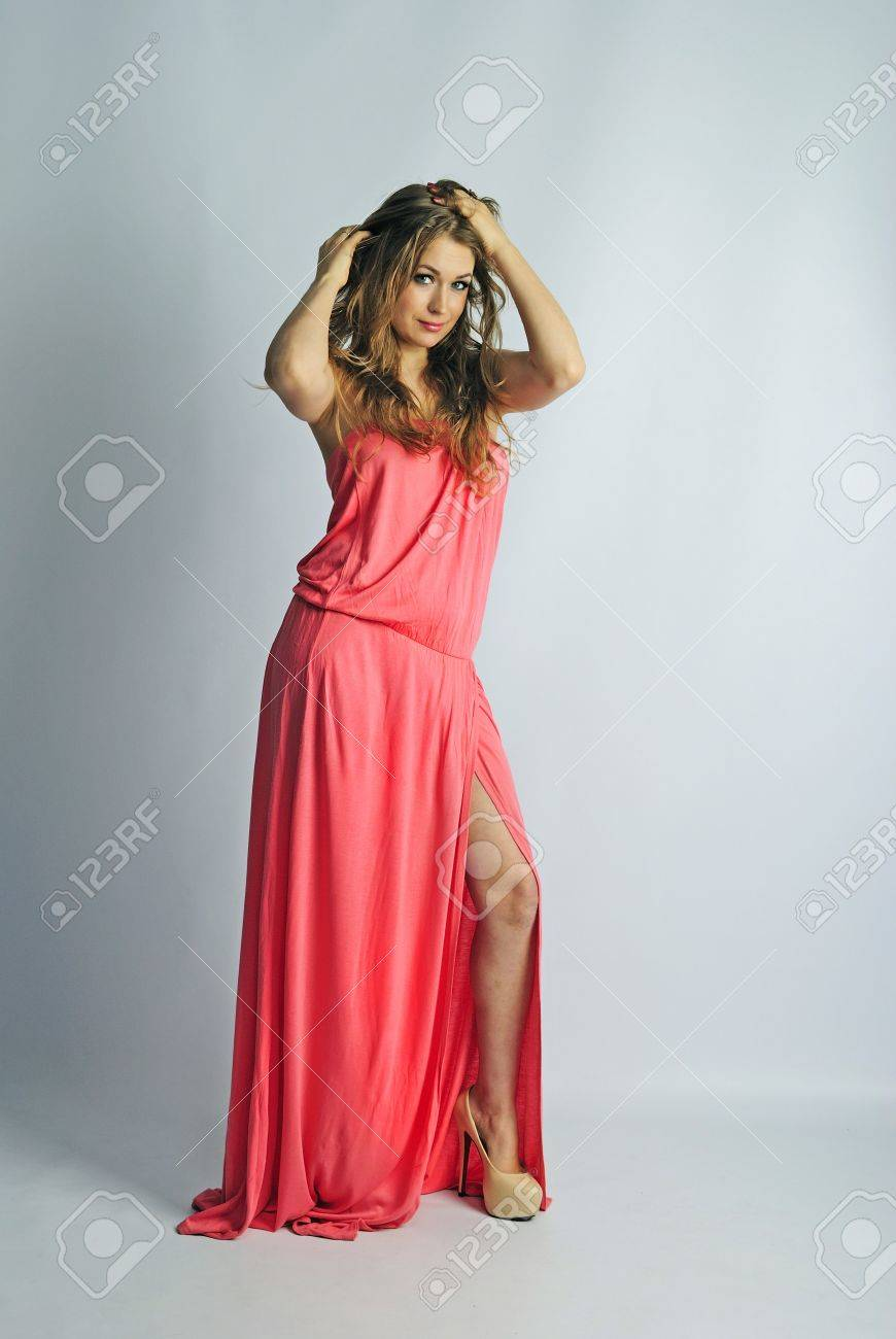 making look younger beautiful girl in rose long year peasant woman's dress with long hair on white background Stock Photo - 19262016