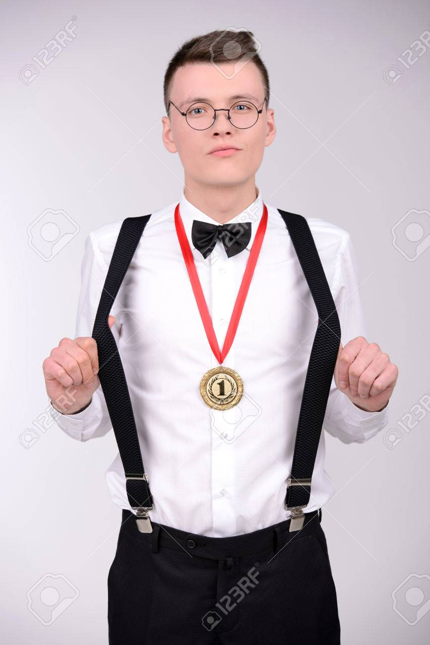 c380a98d6aea I Am Winner! Cheerful Young Man In Bow Tie And Suspenders Showing ...
