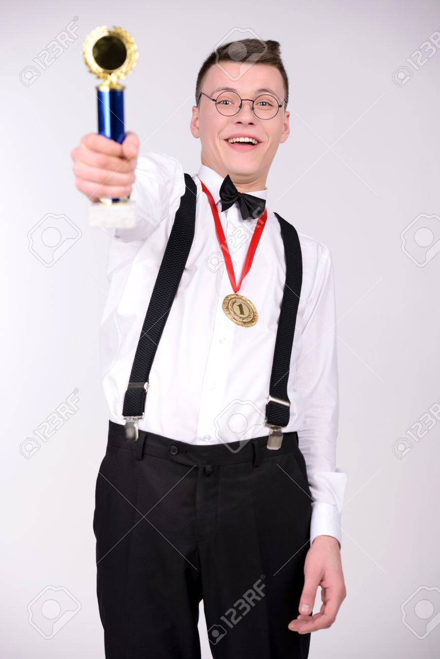 d38107d6efc7 I Am Winner! Cheerful Young Man In Bow Tie Holding A Trophy And ...