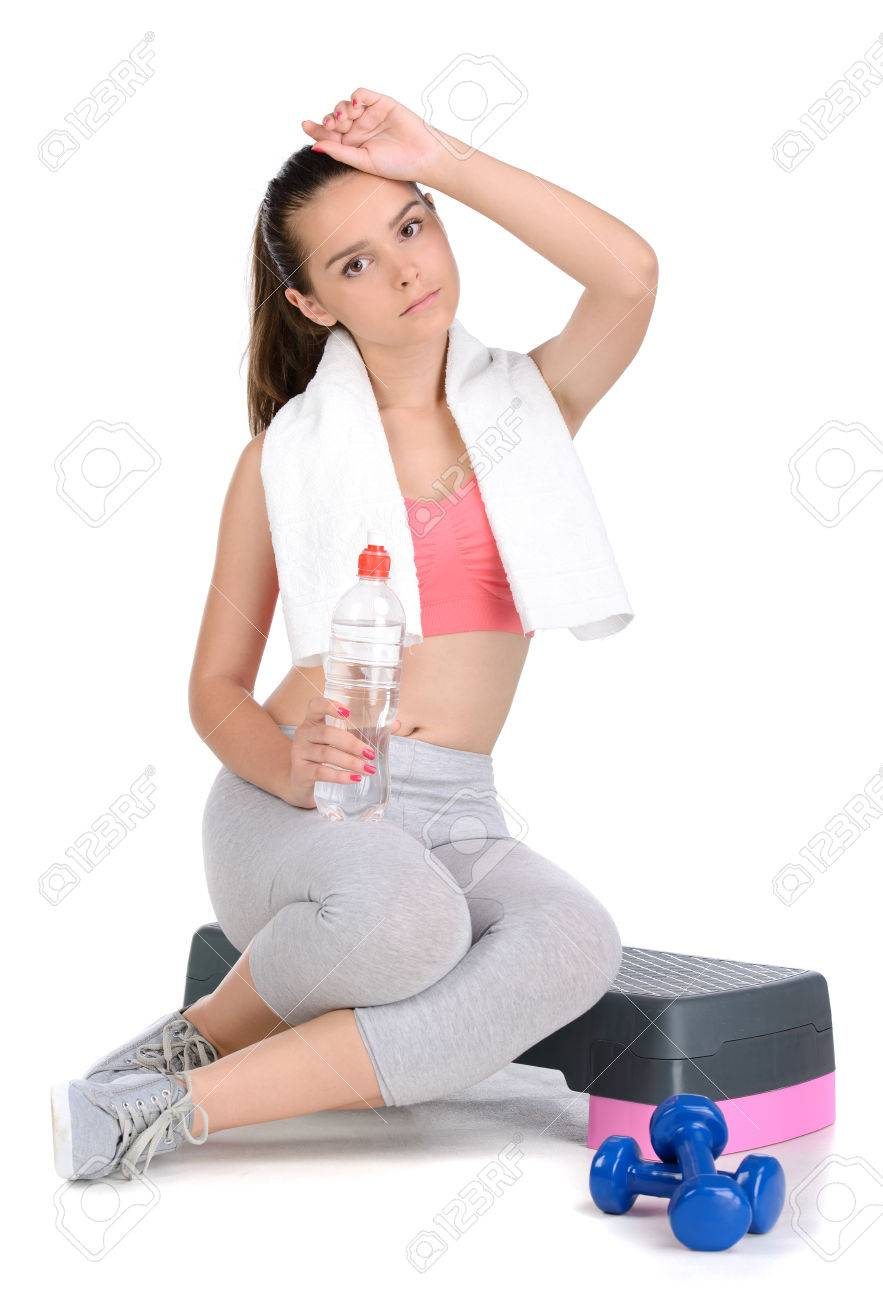 Portrait of teen girl fitness workout, holding towel and water,