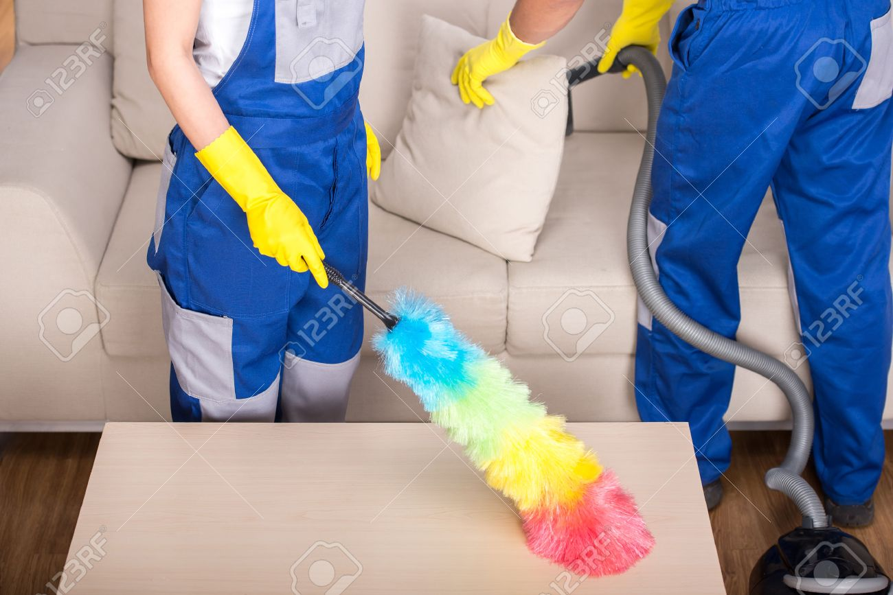 Clean The House: Young Couple Professional Cleaners Are Cleaning The House.  Stock Photo