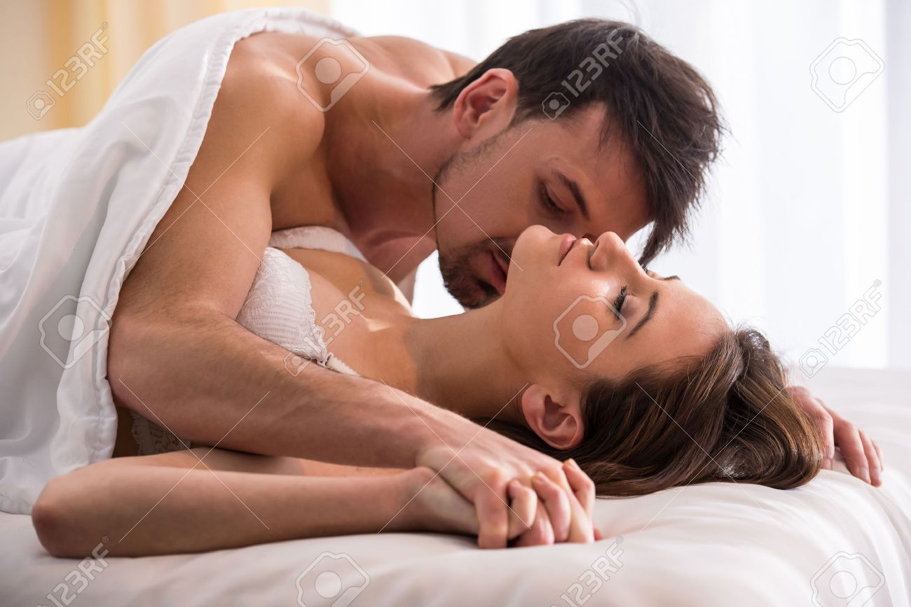 Stock Photo Young love couple in bed romantic scene in bedroom Young Love  Couple In. Love In Bed   emotibikers com