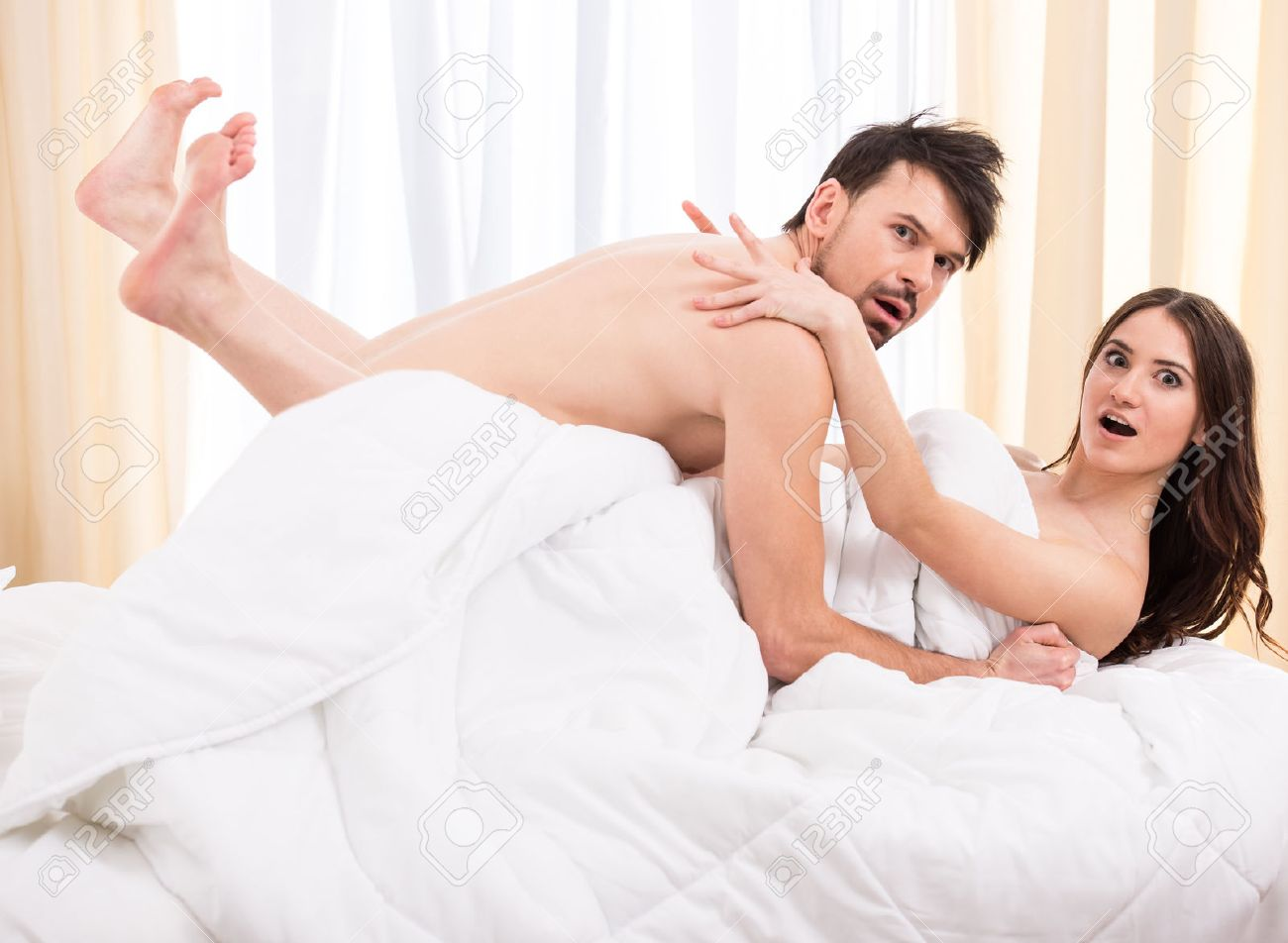 Stock Photo   Young love couple in bed  romantic scene in bedroom