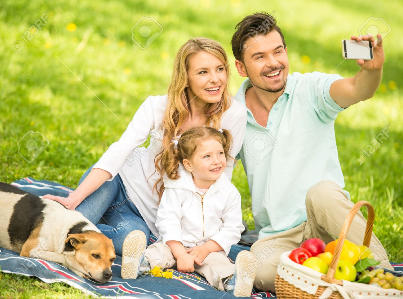 570b375985d Image of happy young family having picnic outdoors and making selfie. Stock  Photo - 40623050