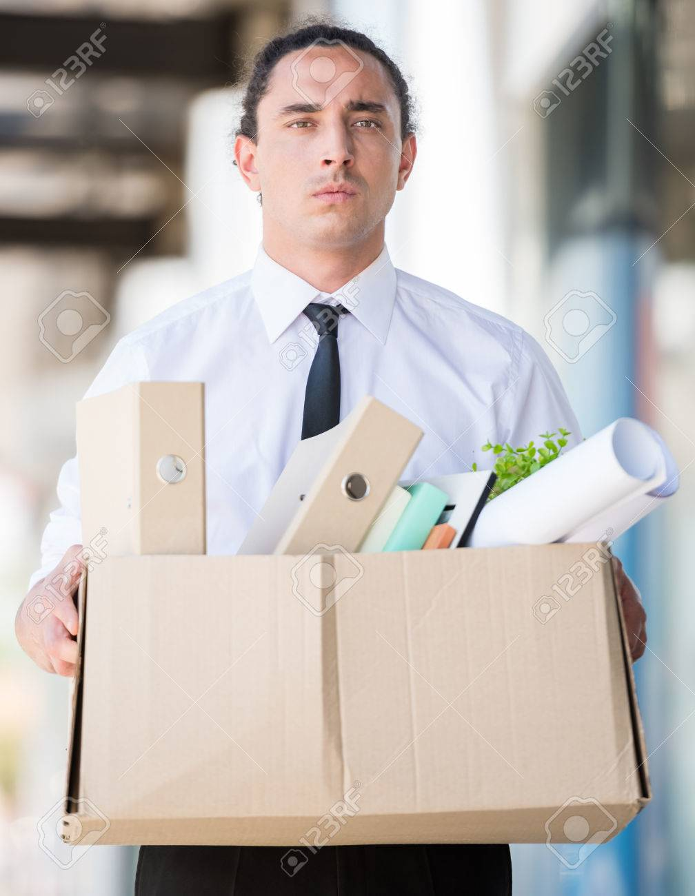 Frustrated office worker on the phone holding stock photo image - Fired Frustrated Man Holding Box With Files Ar Office Stock Photo 40997629