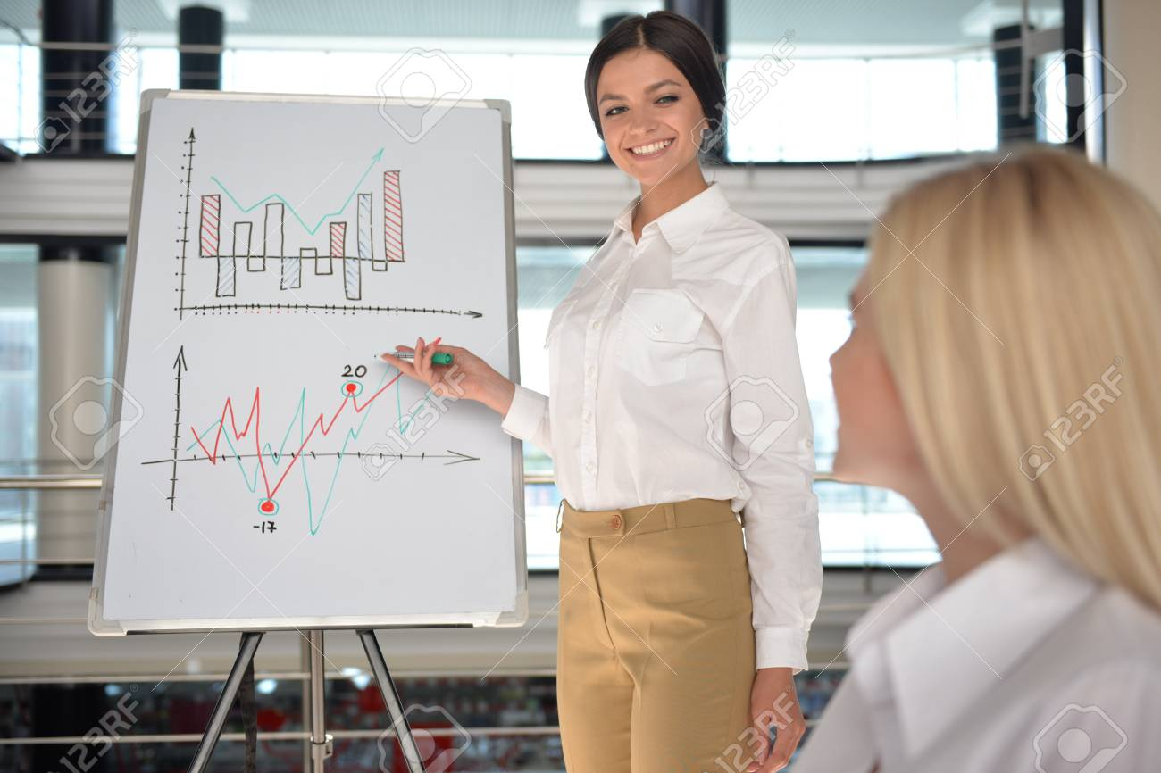 stock photo young successful marketologist presenting new business plan to colleagues at meeting room