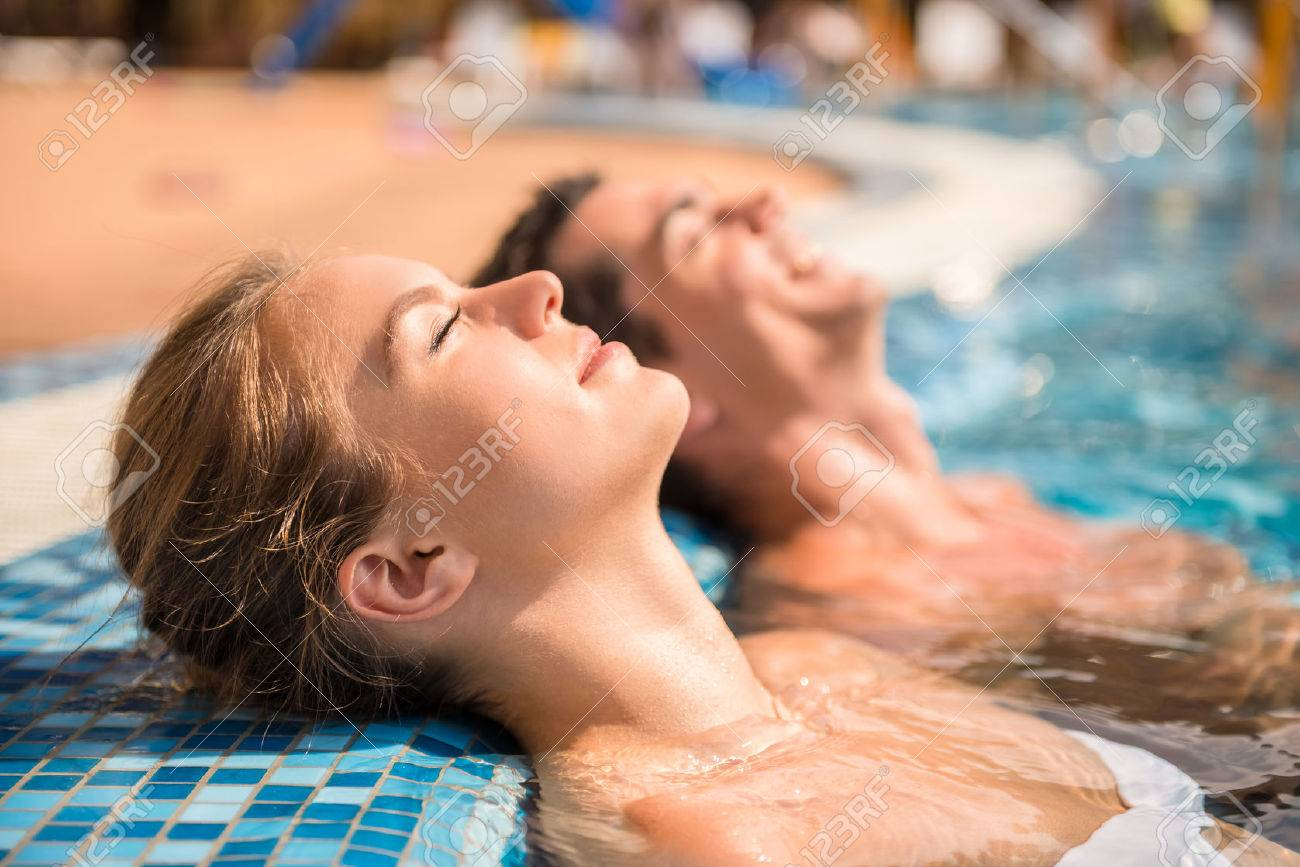 Young couple are relaxing in swimming pool. - 45032753