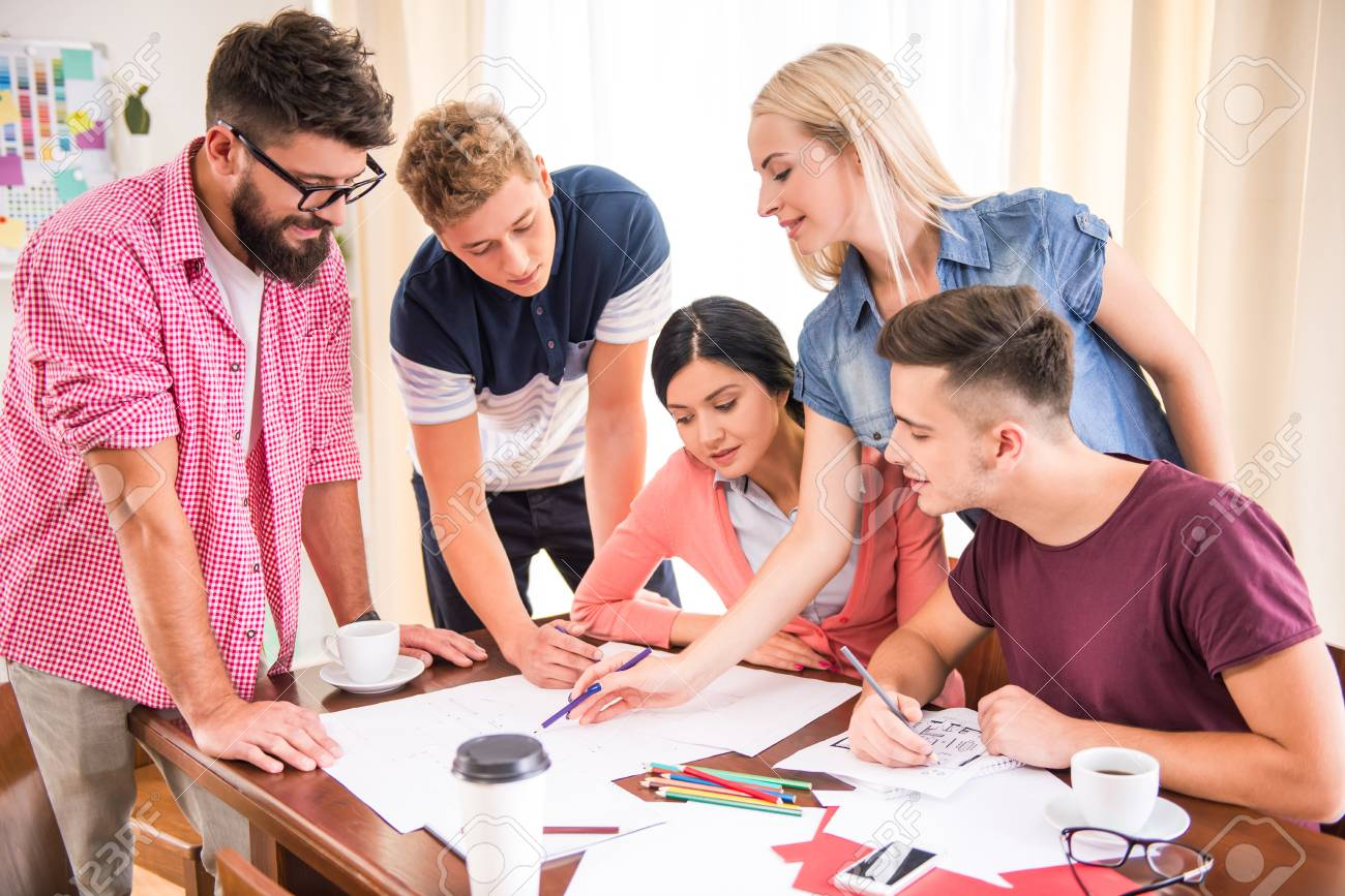 A Group Of Young People Working In The Office Stock Photo, Picture And  Royalty Free Image. Image 45942368.