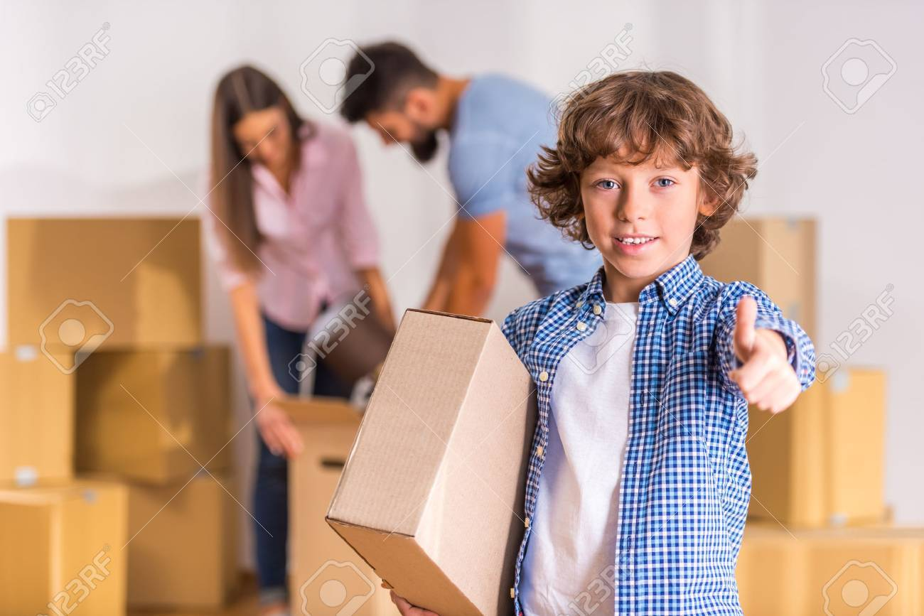 Young happy family moving to a new home with boxes Standard-Bild - 46977883