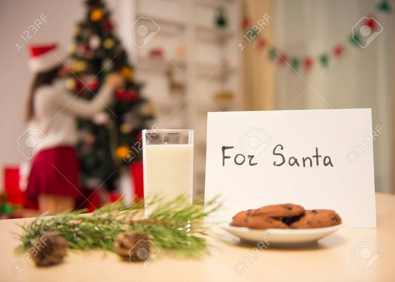 Milk And Cookies For Santa On The Table Celebrating Christmas