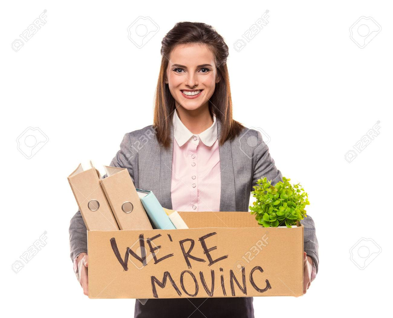 Young happy business woman with a box to move to a new office. Studio shot, isolated on a white background Standard-Bild - 47909435