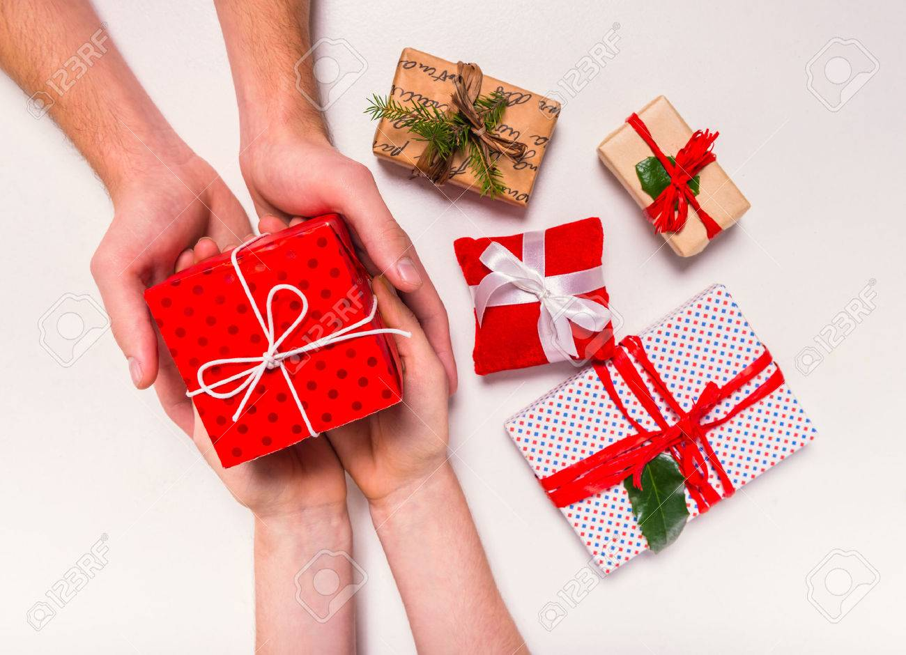 Hand holding box for a gift isolated on a white background Standard-Bild - 49847659