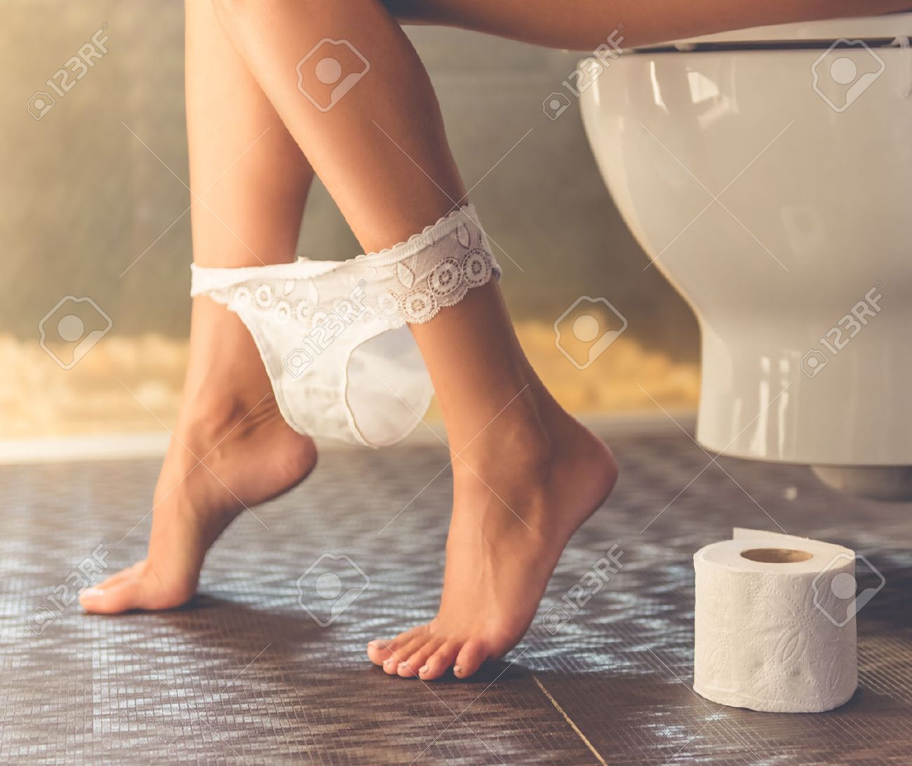 Panties at her ankles
