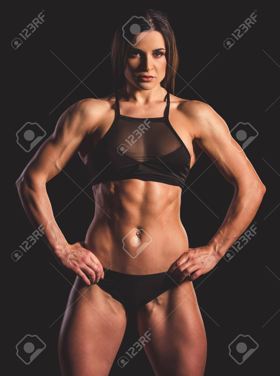 Beautiful strong muscular woman in black underwear on dark background Stock  Photo - 73399135 c19dc1145