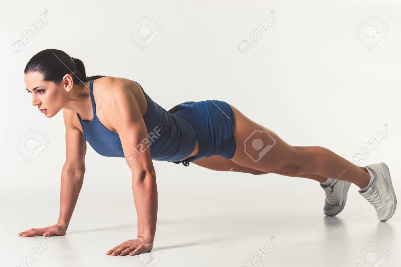 Beautiful Strong Woman In Sportswear Is Doing Plank Exercise ... 6b9e0520f