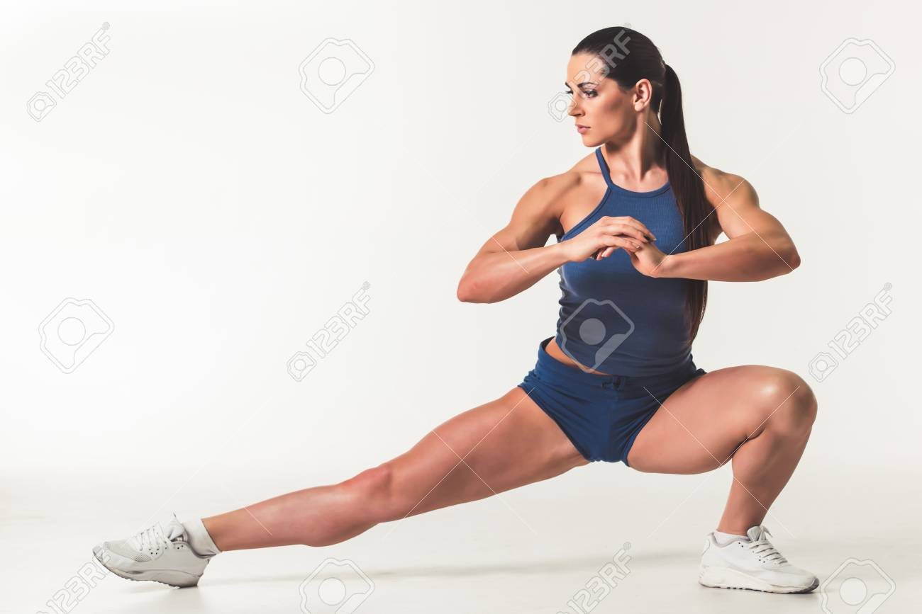 Beautiful Strong Woman In Sportswear Is Working Out 19c6f3854