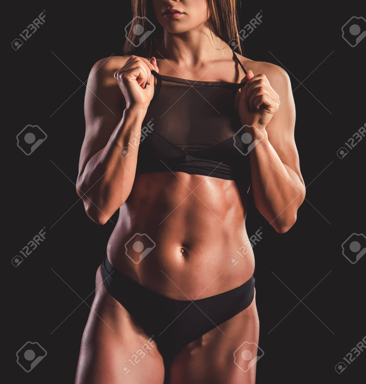 Beautiful strong muscular woman in black underwear on dark background Stock  Photo - 73399144 9b1c9a002