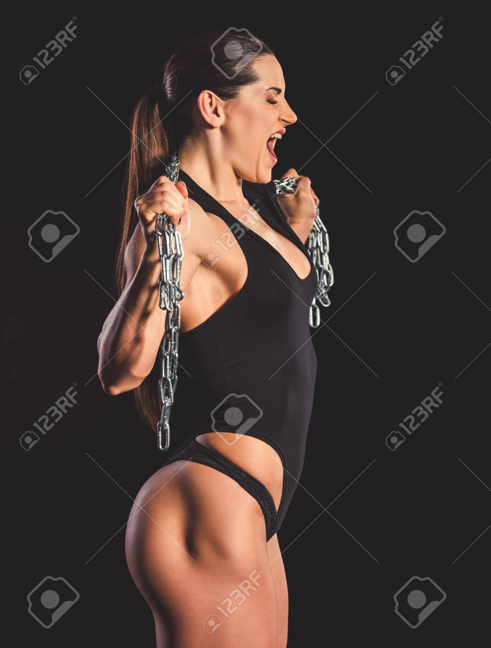 Beautiful strong muscular woman with iron chain on dark background Stock  Photo - 73416445 4b1e960e3