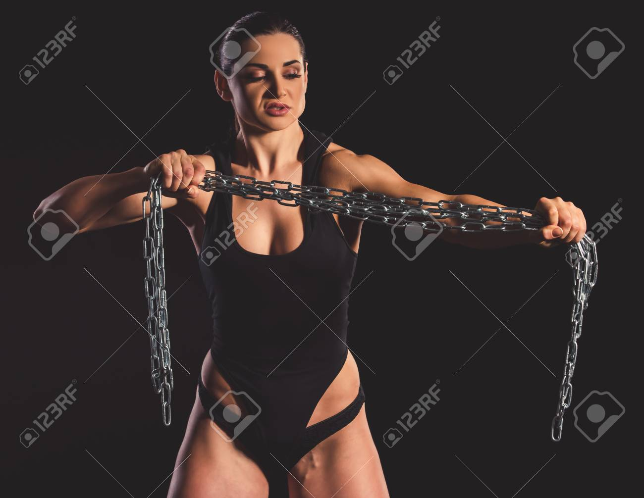 Beautiful strong muscular woman with iron chain on dark background Stock  Photo - 73416179 7d0c099ff
