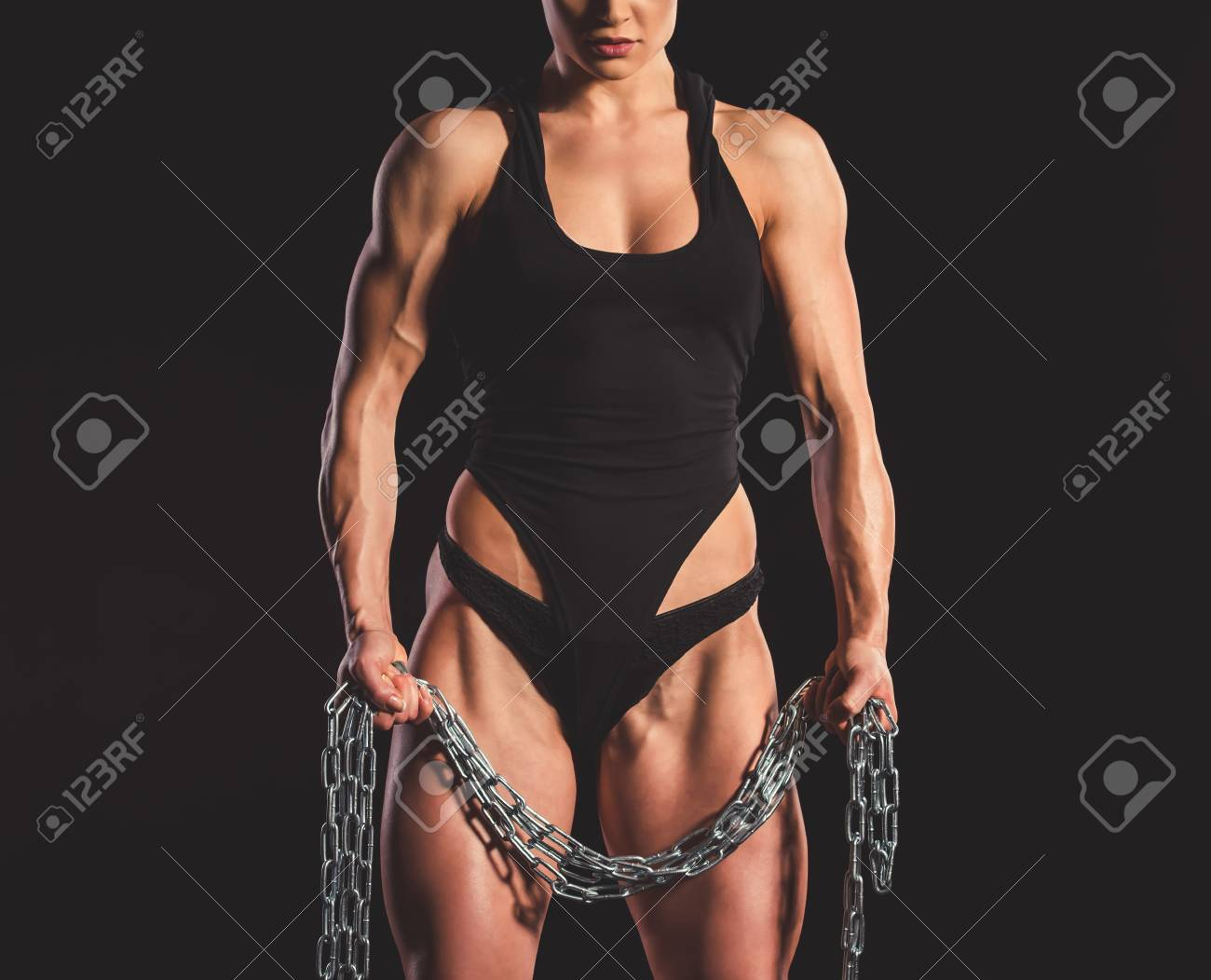 Beautiful strong muscular woman with iron chain on dark background Stock  Photo - 73416432 3bab952c6
