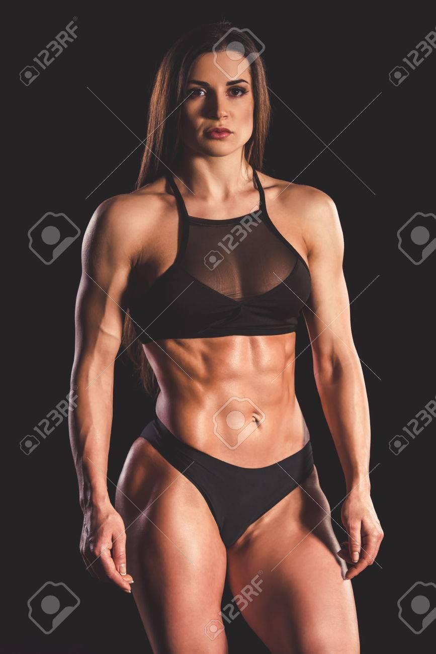 Beautiful strong muscular woman in black underwear on dark background stock  photo jpg 867x1300 Muscle girl 0c5fe8007