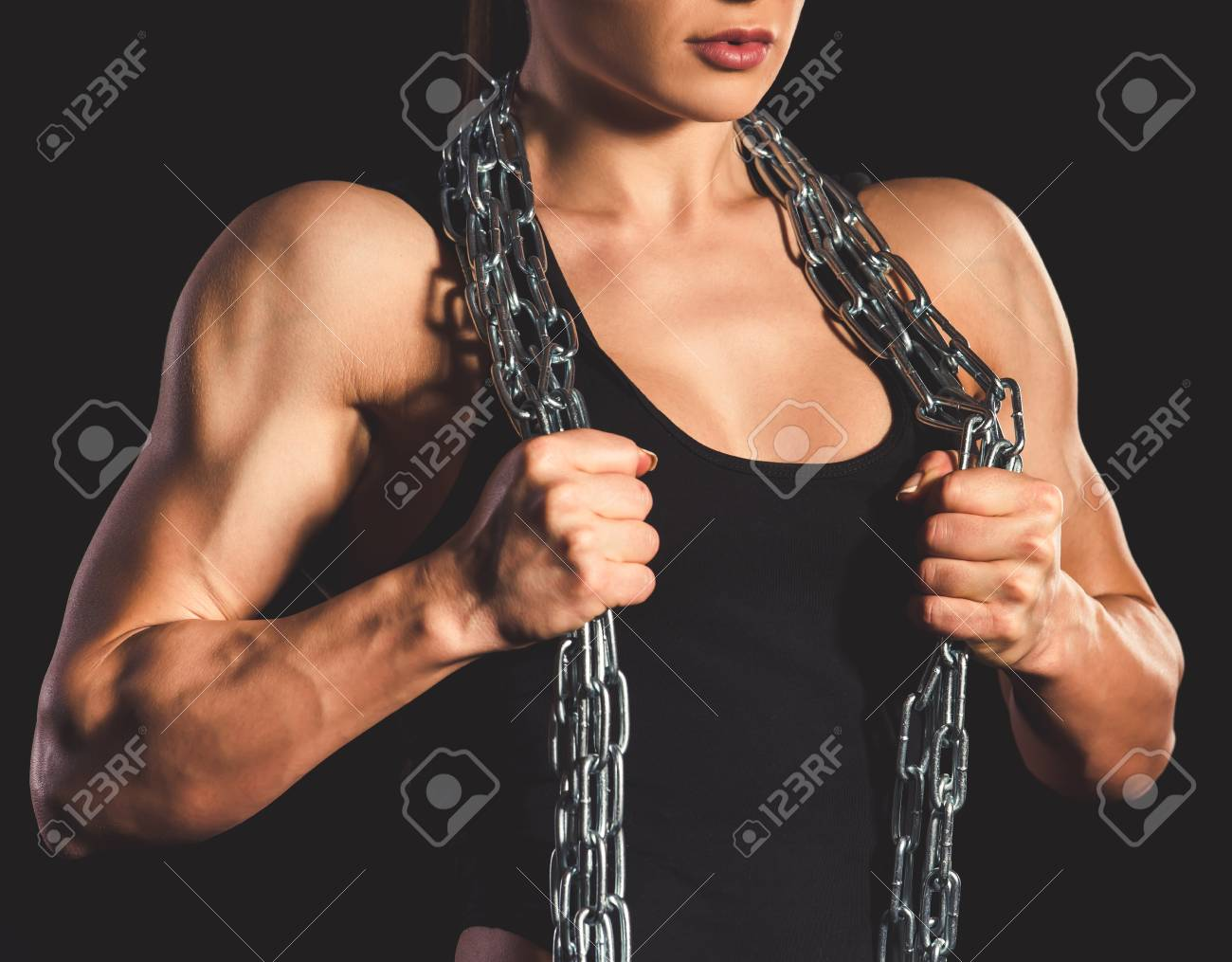 Beautiful strong muscular woman with iron chain on dark background Stock  Photo - 73399100 559944f64