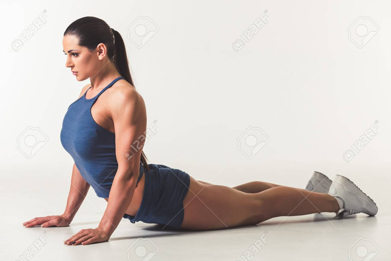 Beautiful Strong Woman In Sportswear Is Stretching 20bef2a9a