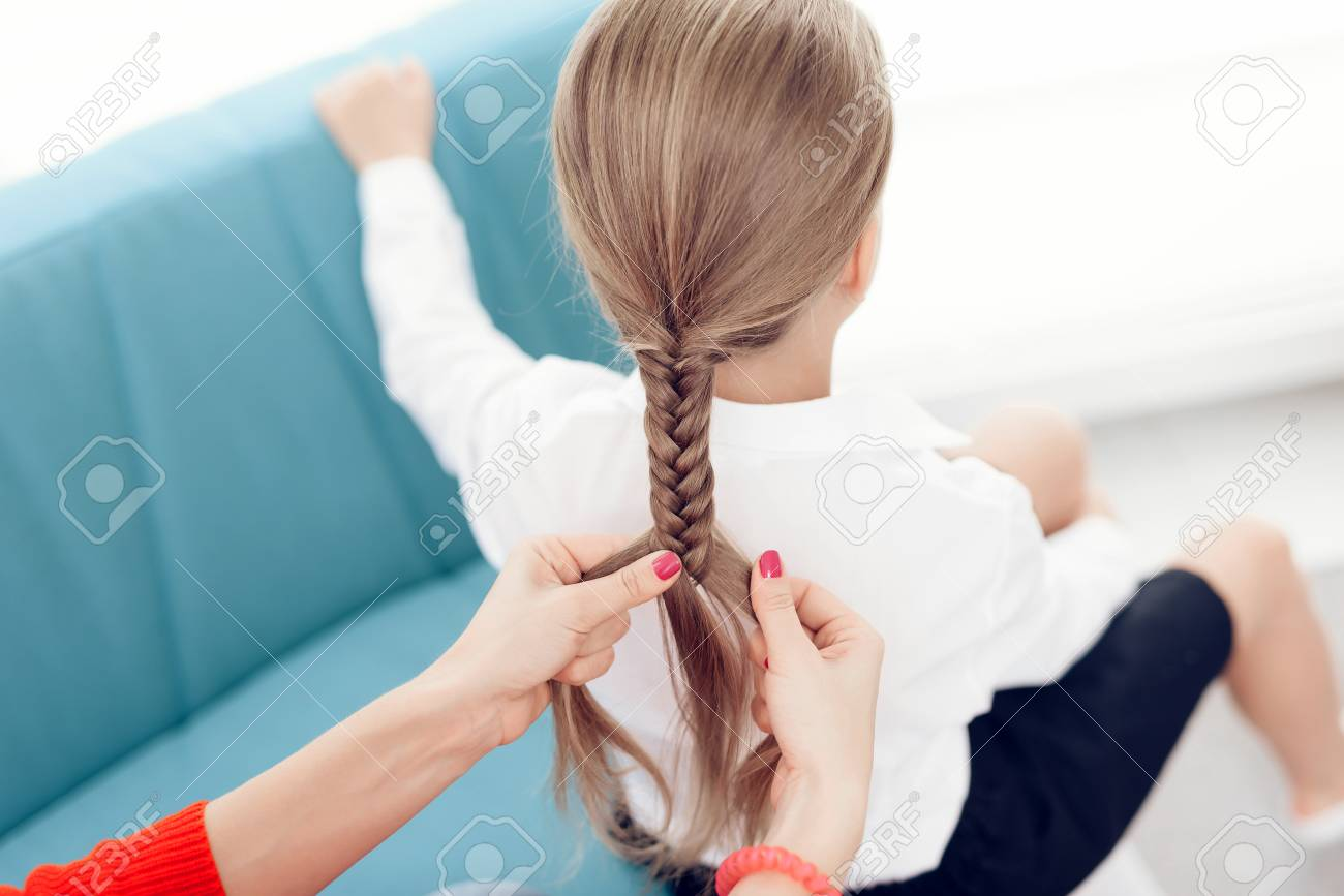 Stupendous The Mother Braids Her Daughters Hair A Woman Plaits A Braid Schematic Wiring Diagrams Phreekkolirunnerswayorg