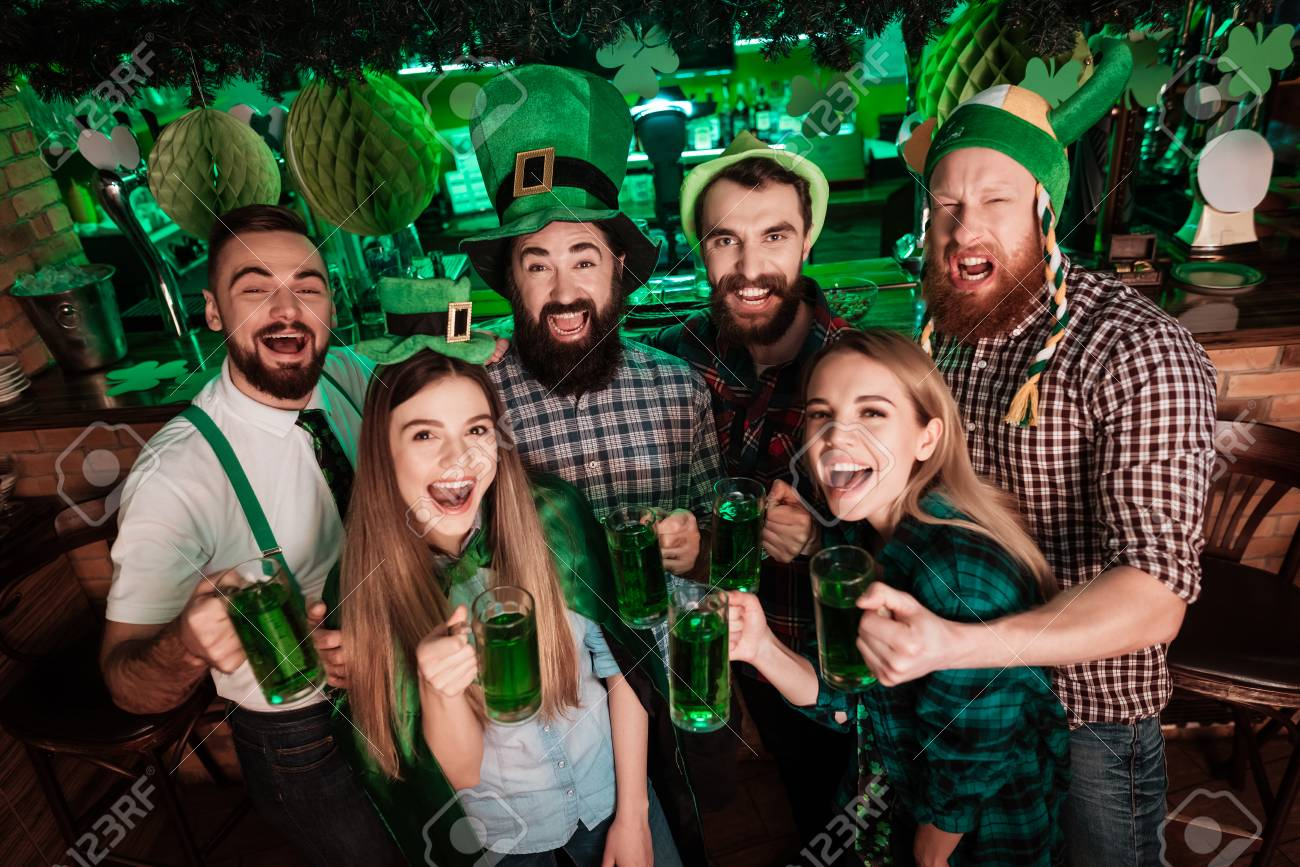 The company of young people celebrate St. Patricks Day. - 93605244