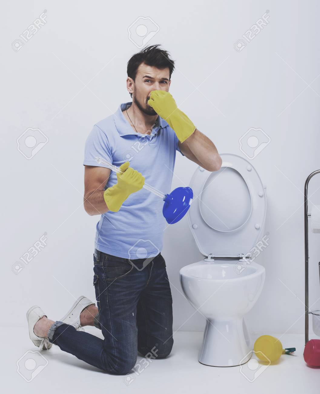 Wondrous Young Man Covering Nose To Avoid Bad Smell While Cleaning Smelly Download Free Architecture Designs Salvmadebymaigaardcom