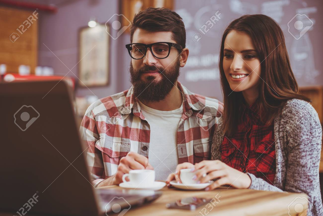 Couple Watching Film in Coffee House  Bearded Hipster  Man and