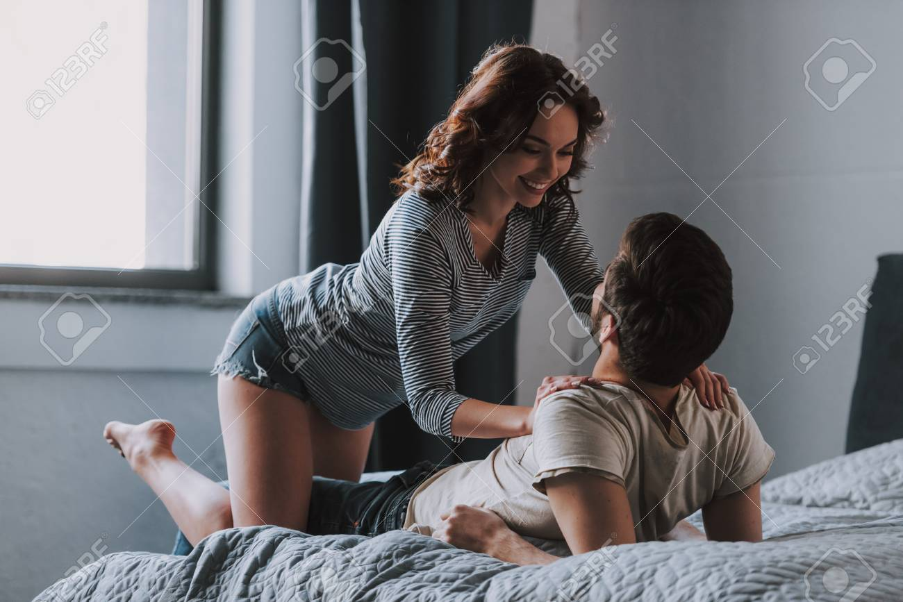 Happy Couple Together Having Fun in Bedroom  Roll on the Back