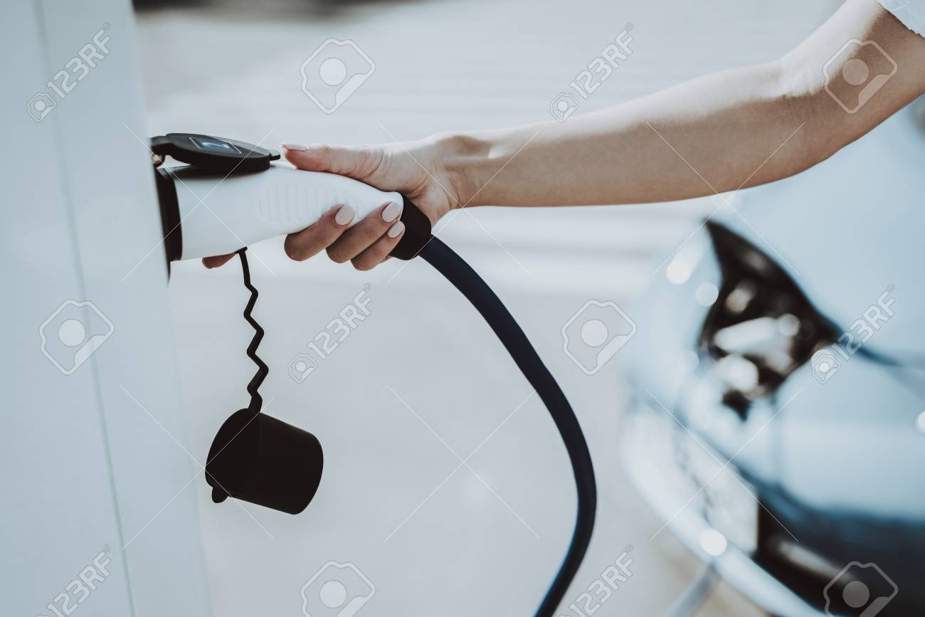 Car Cable Plug In A Socket. Automobile Charging Station Concept. Innovation Technology. New Generation Electro Hybrid Vehicle Plugin. Ecology Charge Station. Futuristic Power. - 107994277