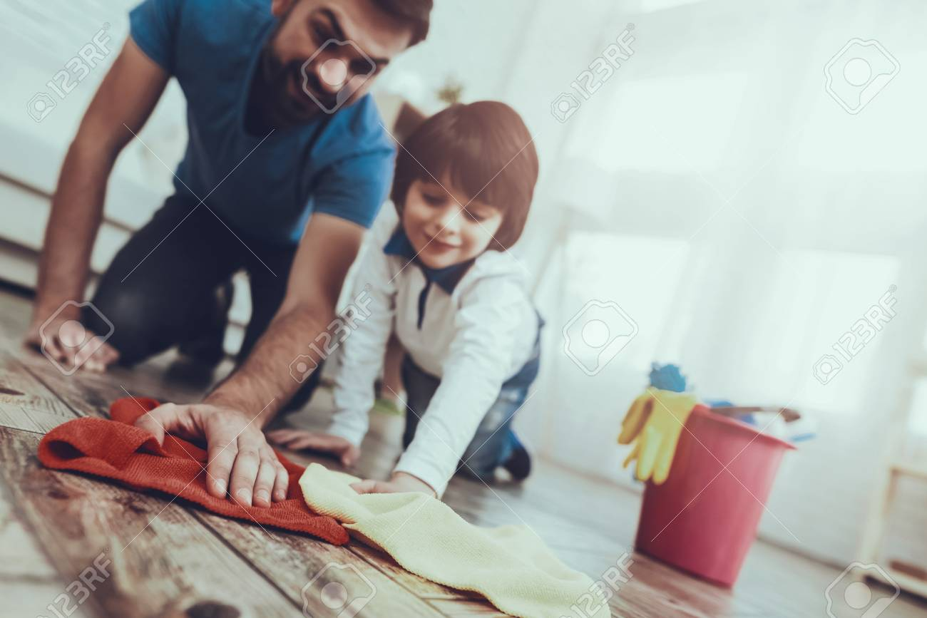 Happy Together. Cleanliness. Smile. Have Fun. Clean House Together. Family. Holidays.Two Boys. Father. Baby with Bright Hair. Smiling Kid. Spends Time. Home Time. Father Two Boys. Leisure Time. Man. - 108890453