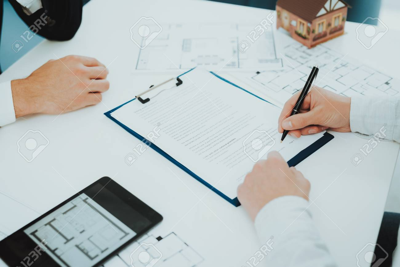 Close-up. Contract Signing Concept. Property Buy. Bright Office. Business Meeting. Customer And Buyer. Offer Discussion. Professional Agreement. House Selling Proposal. Document Signature. - 110179073