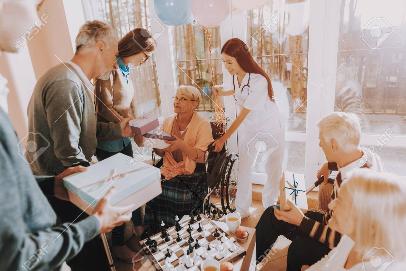 Guests Give Gifts To Elderly Woman Birthday Party Celebration Very Happy Young And Old