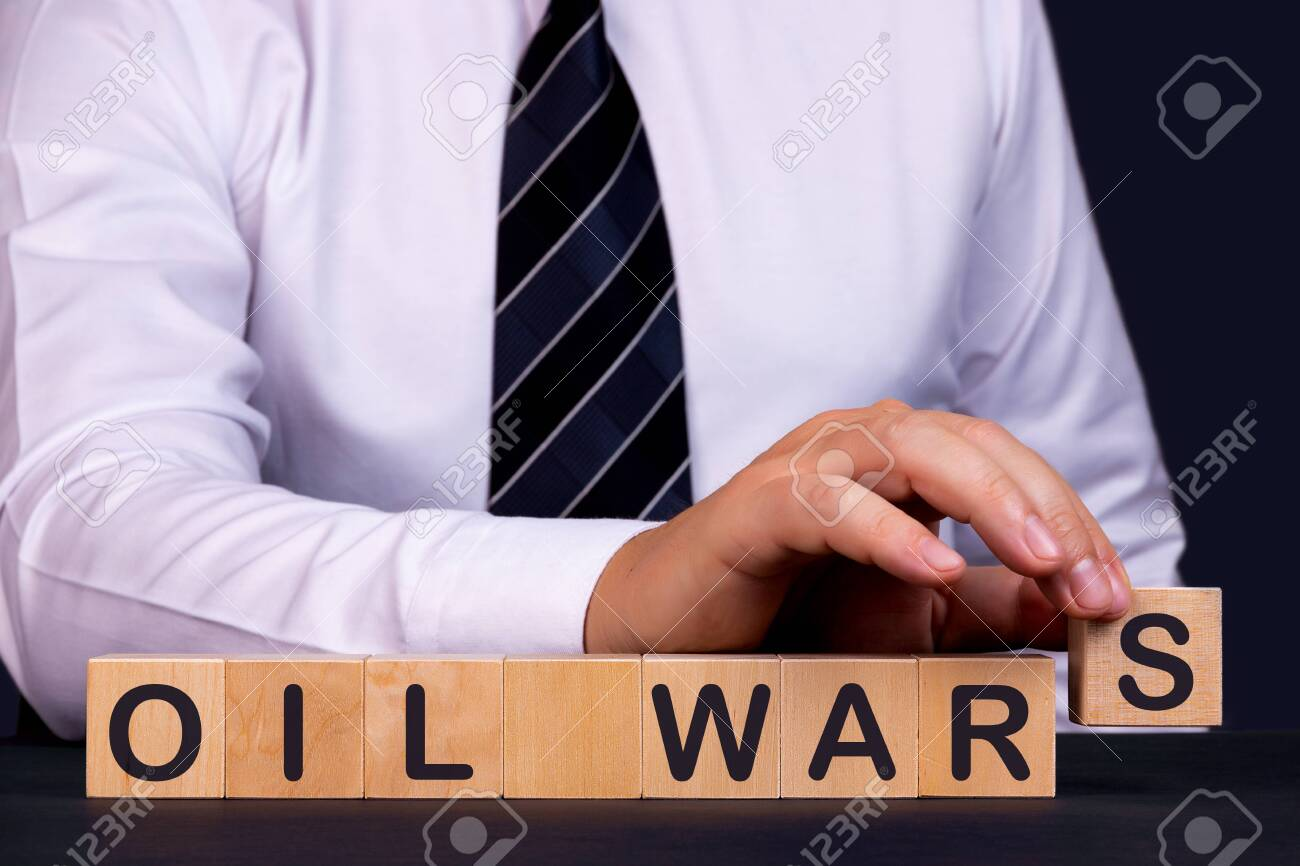 Man made word Oil Wars with wooden blocks. Business concept. - 144994660