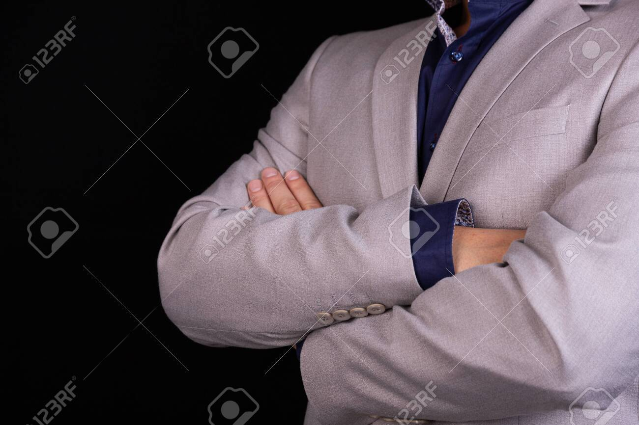 https www 123rf com photo 148070944 businessman in a gray suit with folded arms on a black background business finance ideas html