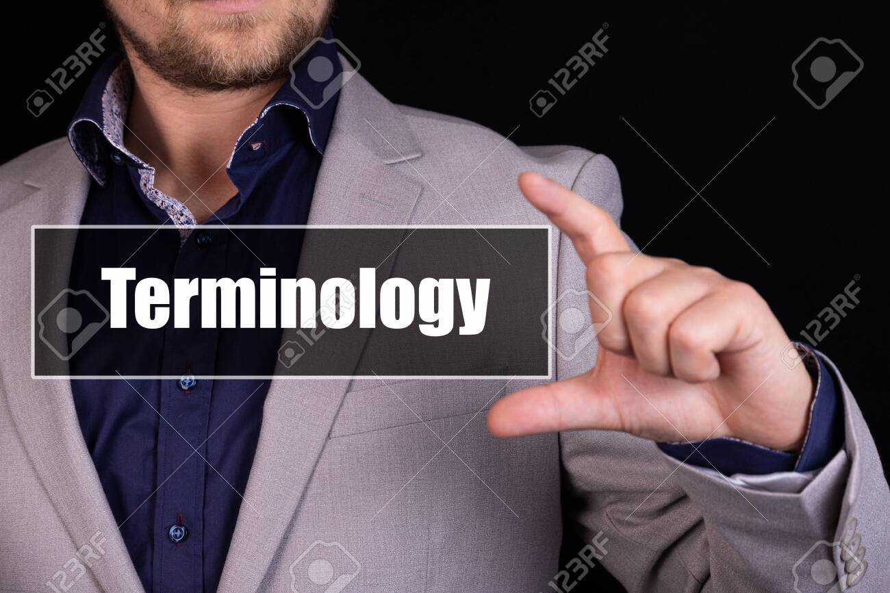 Businessman on a black background holds an icon with the text Terminology - 148396634