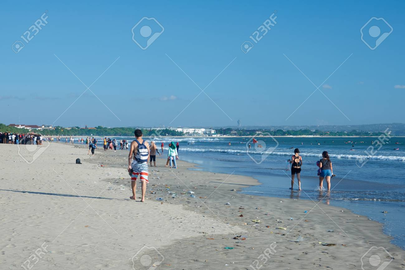 Trash On The Kuta Beach In Bali Many People Walk Among Garbage