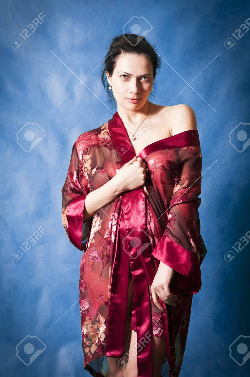 Beautiful brunette in a red negligee Stock Photo - 76336933 594d4042b
