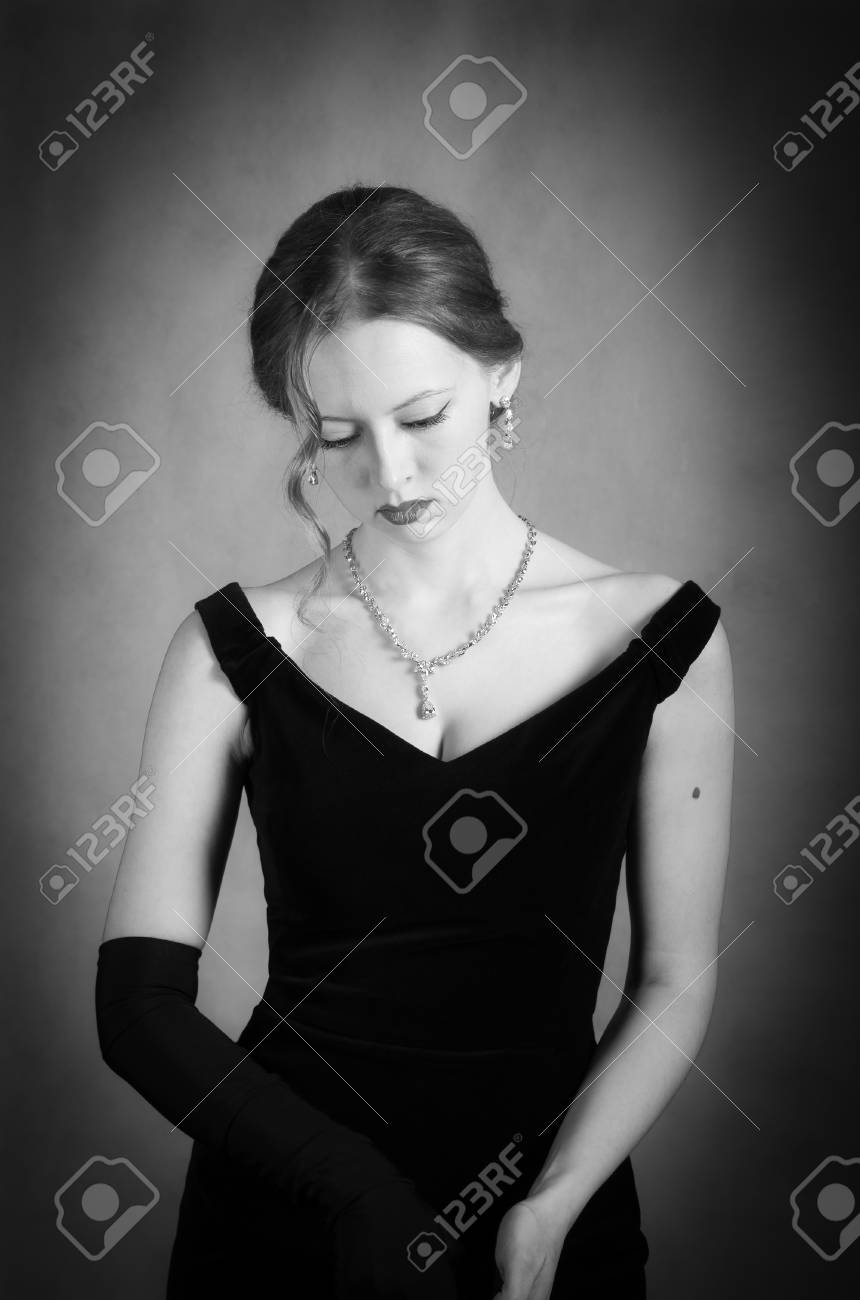 Girl In Evening Dress Taking Off Long Gloves Black And White