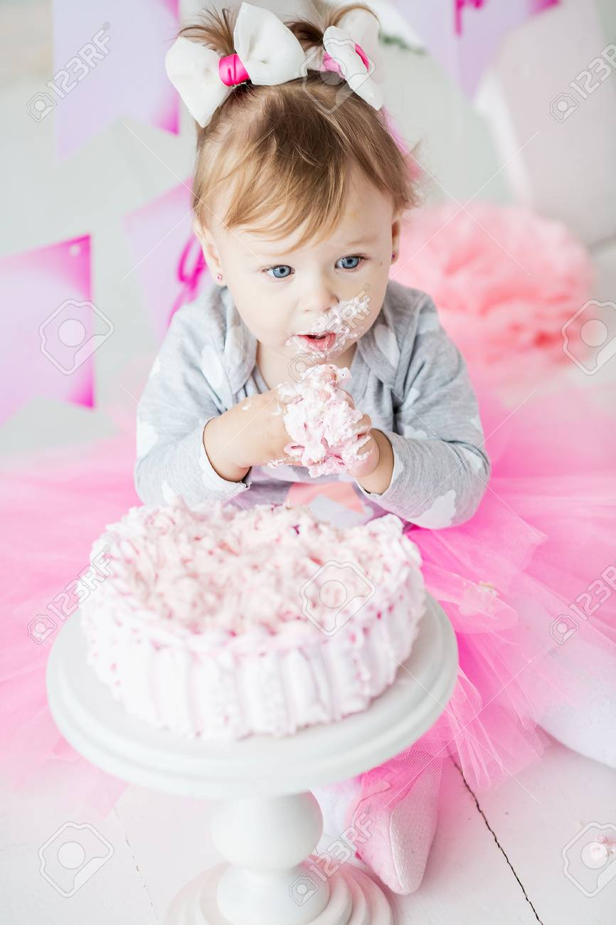 Baby Girl 1 Year Old Celebrating First Birthday In Room Eating