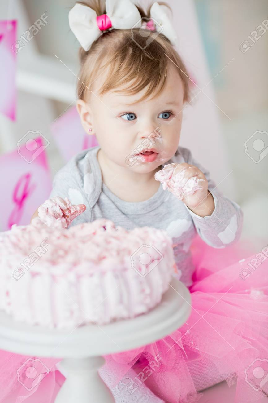 Sensational Baby Girl 1 Year Old Celebrating First Birthday In Room Eating Funny Birthday Cards Online Barepcheapnameinfo